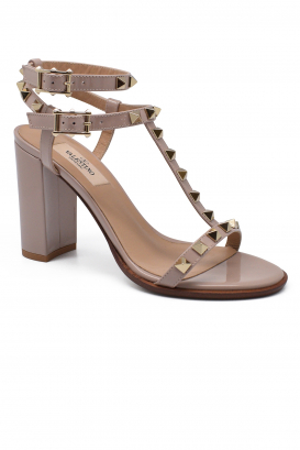 Valentino Rockstud sandals in powder pink patent leather with platinium finish studs and high heel