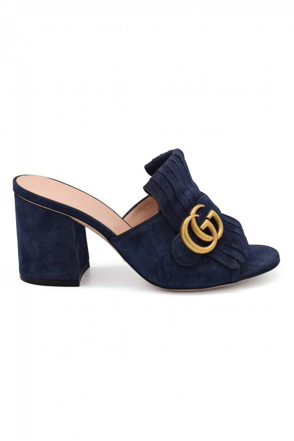 Gucci mules in blue suede with fringe and gold GG buckle on the front