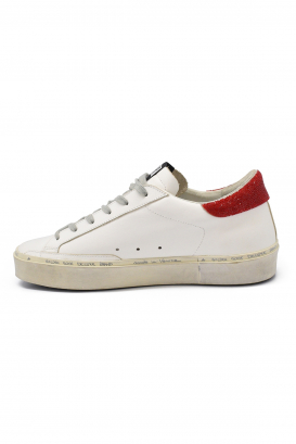Golden Goose lace-up sneakers in white leather with silver glittered star, red glittered heel tab, and oversize sole