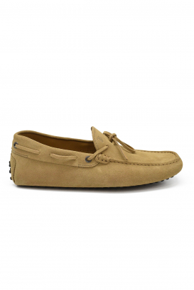 Tod's loafers in beige suede with knotted laces at the front and rubber sole with barbs