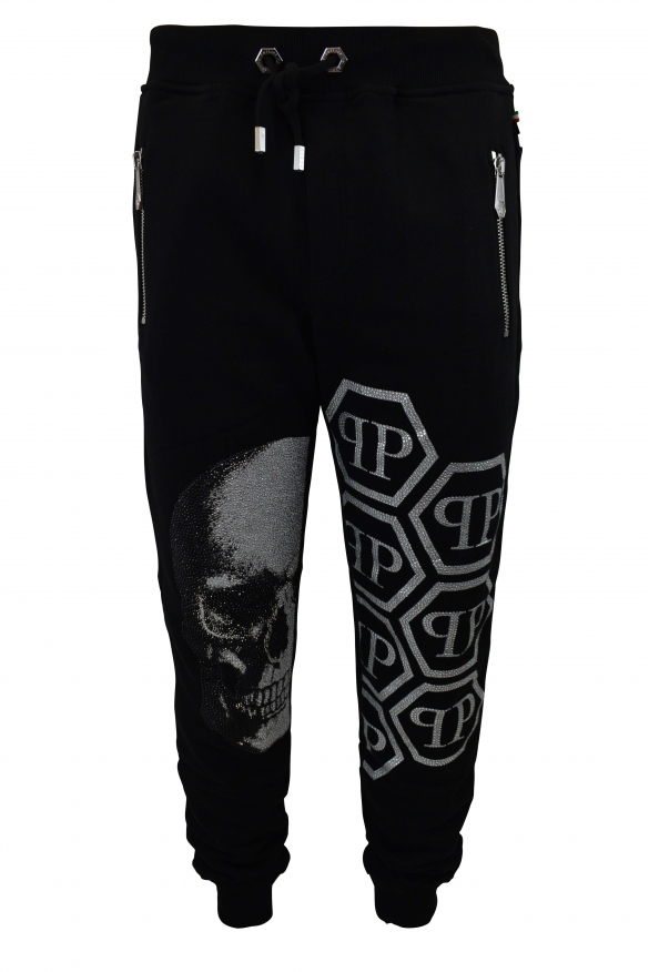 Philipp Plein black joggers with white full strass skull on one leg and white PP logos with strass on the other